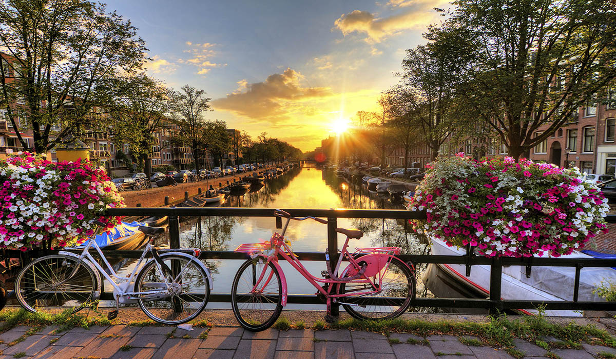 Amsterdam bikes over water and sunset